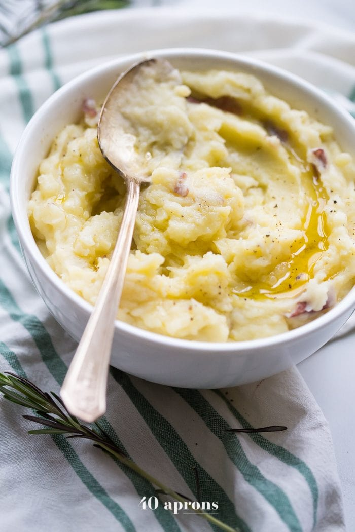 These Whole30 Instant Pot mashed potatoes with garlic and herbs are a Whole30 Thanksgiving dream: rich, creamy, garlicky, and so easy. These Whole30 Instant Pot mashed potatoes are a must for any paleo Thanksgiving table or Whole30 Thanksgiving table, and they'll become your favorite paleo Instant Pot mashed potatoes recipe for sure!