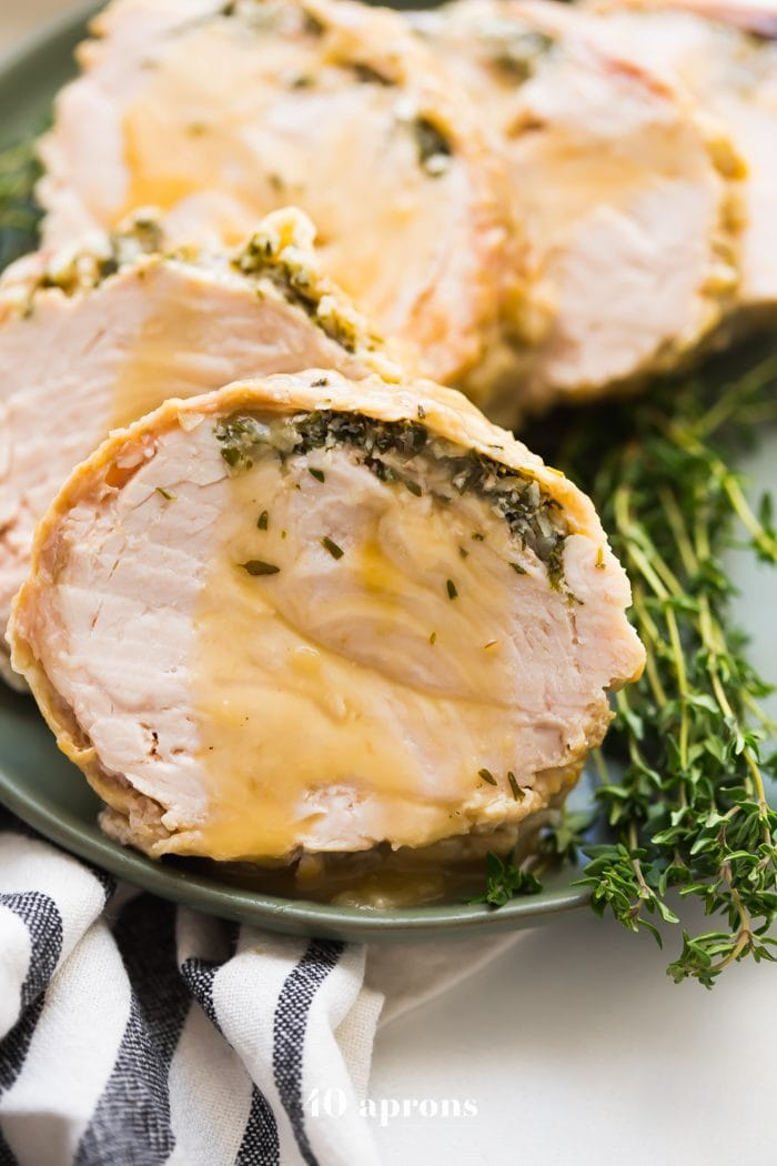 This Whole30 Instant Pot turkey breast with gravy is quick, so delicious, and totally Whole30 compliant. Brined with a garlic-herb butter under the skin, this Whole30 turkey breast and the gravy are both made in the Instant Pot, making Thanksgiving easier! You'll love this Whole30 Instant Pot turkey breast and gravy, because the meat is so tender, and the gravy is so easy. Perfect for any Whole30 Thanksgiving or paleo Thanksgiving table.