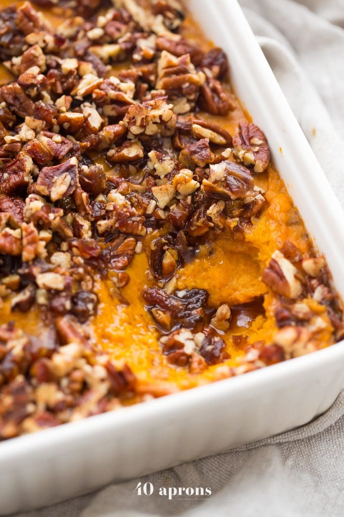 This Whole30 sweet potato casserole with pecans is a must for any Whole30 Thanksgiving table! With no sweeteners and a cinnamon pecan-date topping, you might end up eating the leftovers for breakfast (we did!). This Whole30 sweet potato casserole is naturally sweetened and just so delicious. A new Whole30 Thanksgiving classic!