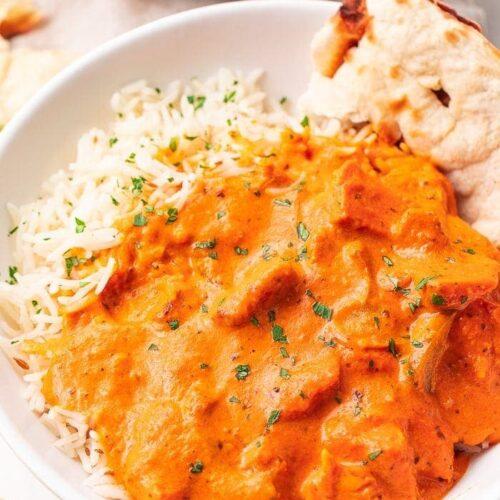 Chicken tikka masala over basmati rice with naan