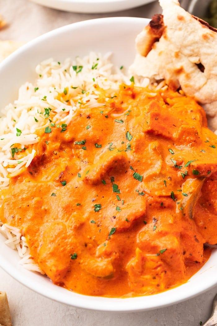 Close up of chicken tikka masala over rice