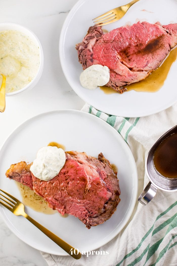This easy prime rib recipe with au jus and *perfect* creamy horseradish sauce is perfect for the holidays! This easy prime rib recipe is truly just that: super easy, and it produces a perfect medium rare, tender roast that everyone will love. With an easy au jus and the most perfect creamy horseradish sauce I've ever tasted, this easy prime rib recipe also has options to make it a paleo prime rib or Whole30 prime rib, too - even the horseradish sauce!