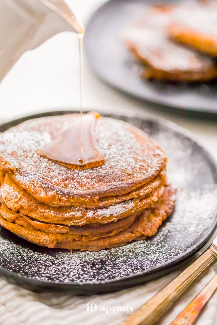 These paleo gingerbread pancakes taste just like a slice of gingerbread cake! Fluffy and rich, these paleo gingerbread pancakes are the best paleo pancakes ever, and no one would know they're paleo at all. Yep, these paleo gingerbread pancakes are theperfectpaleo Christmas morning treat (or any time, if you're at our house!).
