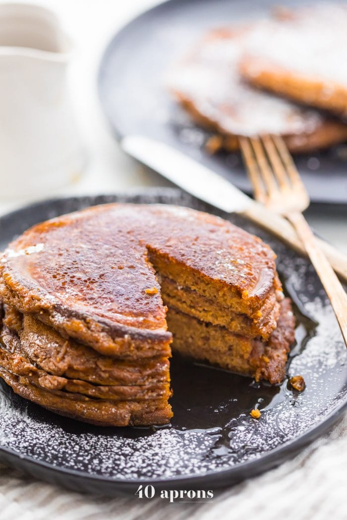 These paleo gingerbread pancakes taste just like a slice of gingerbread cake! Fluffy and rich, these paleo gingerbread pancakes are the best paleo pancakes ever, and no one would know they're paleo at all. Yep, these paleo gingerbread pancakes are the perfect paleo Christmas morning treat (or any time, if you're at our house!).