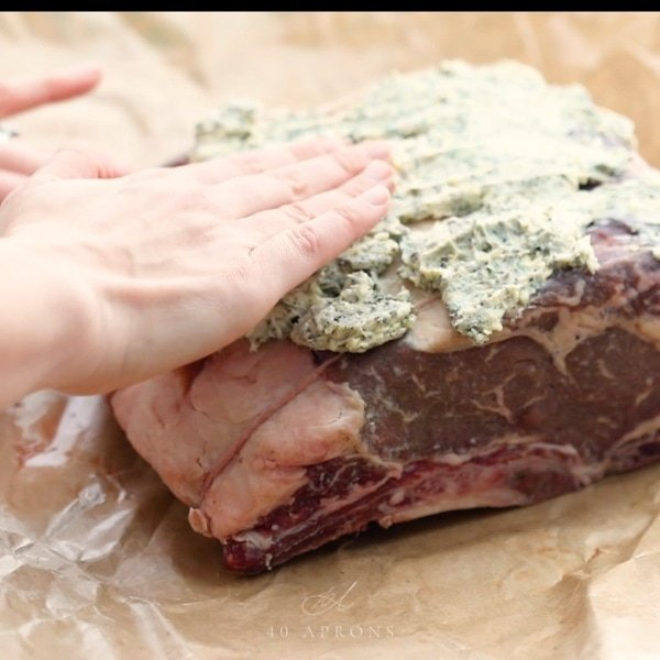 Pat prime rib with butter