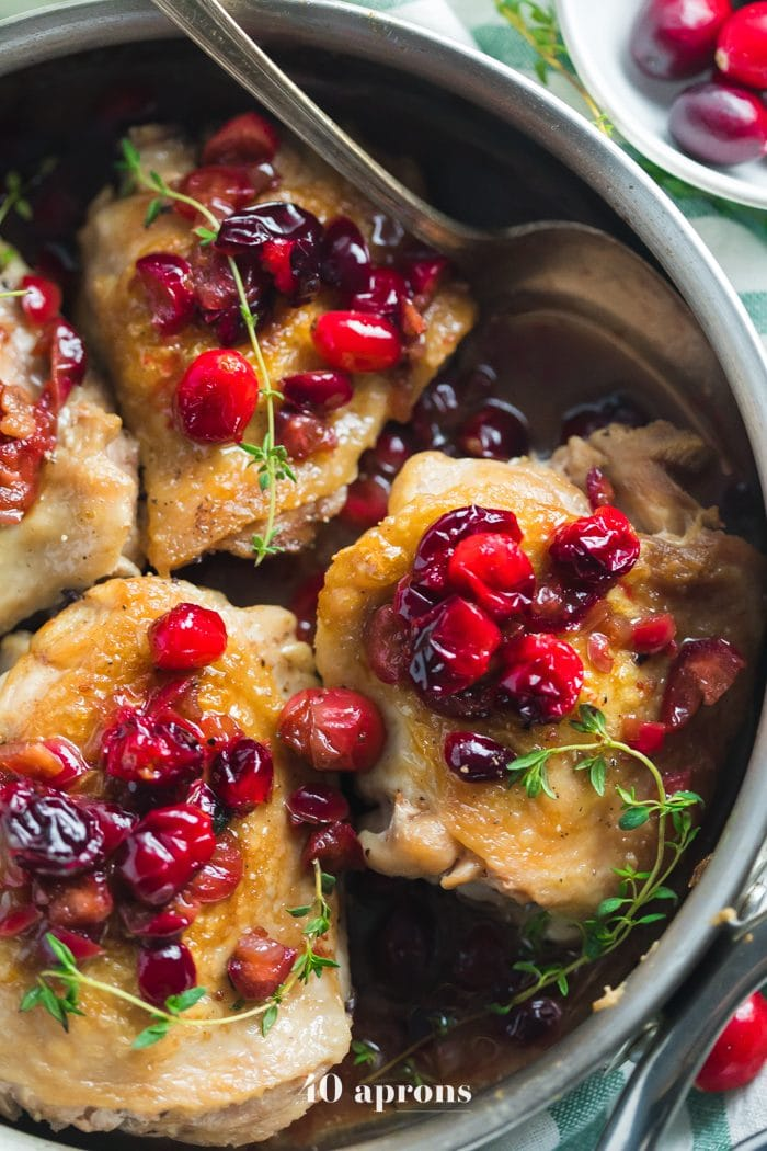 This Whole30 cranberry chicken is a simple but flavorful Whole30 dinner recipe that you'll love in the fall and winter! With just a few recipes, this Whole30 cranberry chicken is so good when you need a fruity flavor but want to keep it quick and easy. Bound to become a favorite Whole30 dinner recipe!