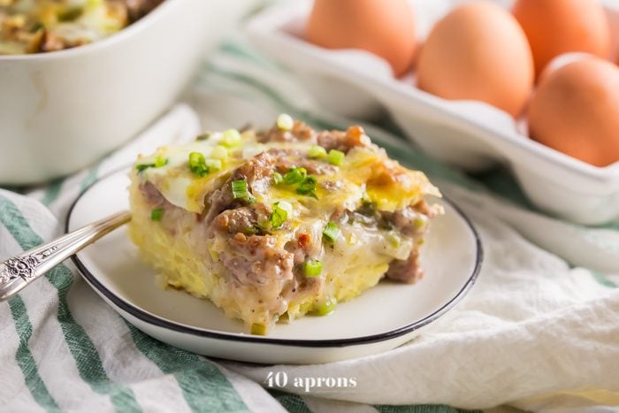 This Whole30 hashbrown and sausage breakfast casserole is healthy Christmas morning breakfast recipe and a perfect Whole30 breakfast recipe. With hashbrowns, a creamy sauce, spicy sausage, and creamy eggs, this Whole30 hashbrown and sausage breakfast casserole is delicious enough to eat for dinner. Filling and flavorful, this healthy Christmas morning breakfast recipe is our fave!