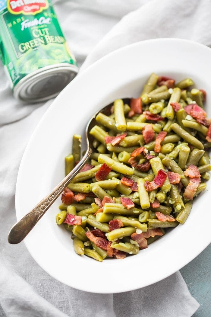 Whole30 Del Monte green beans with bacon in a white dish