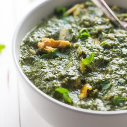 Whole30 Indian saag chicken in a white bowl