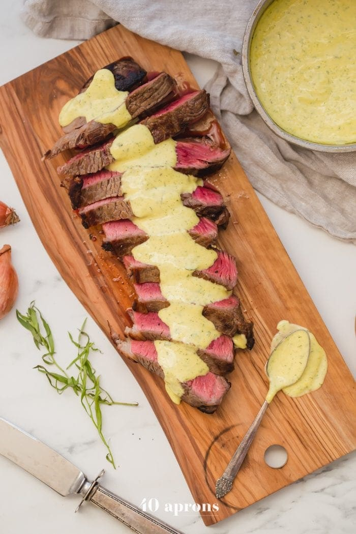 Medium-rare Whole30 steak with Whole30 bearnaise sauce in a dish