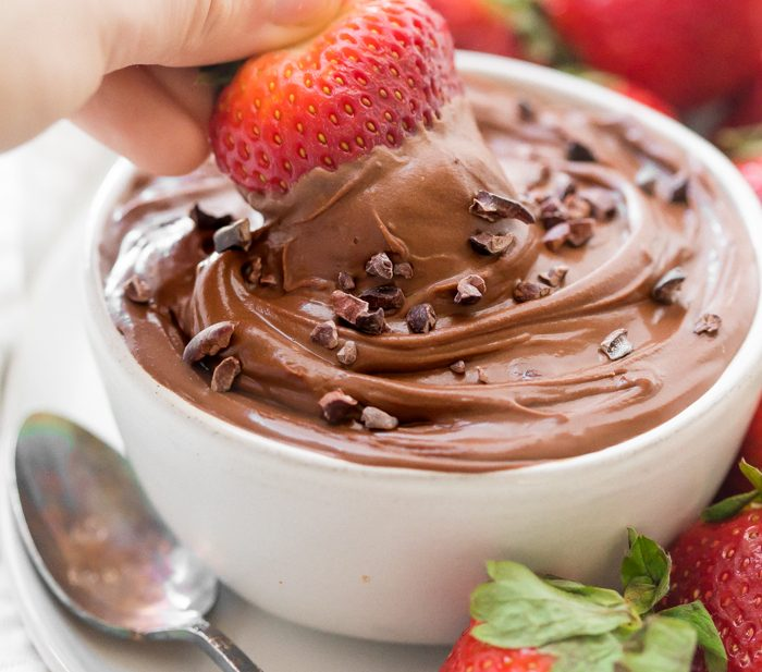 Paleo chocolate mousse dip with strawberry
