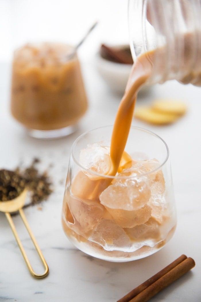 Vegan chai latte pouring