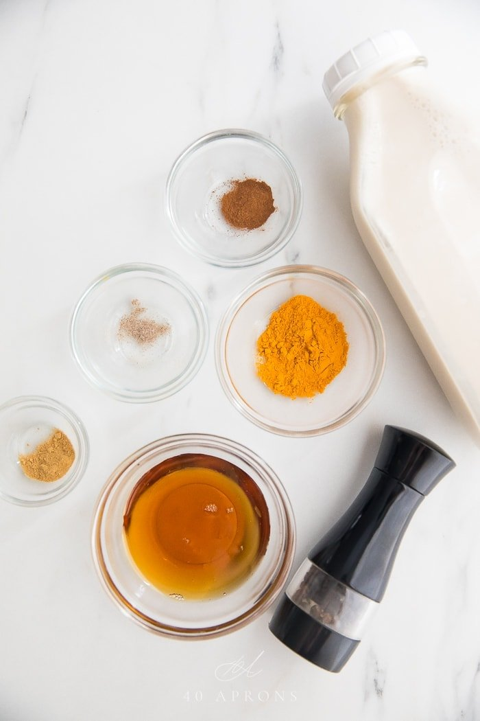 Iced golden milk ingredients: turmeric, spices, and milk