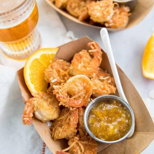 Whole30 coconut shrimp with orange sauce in a container