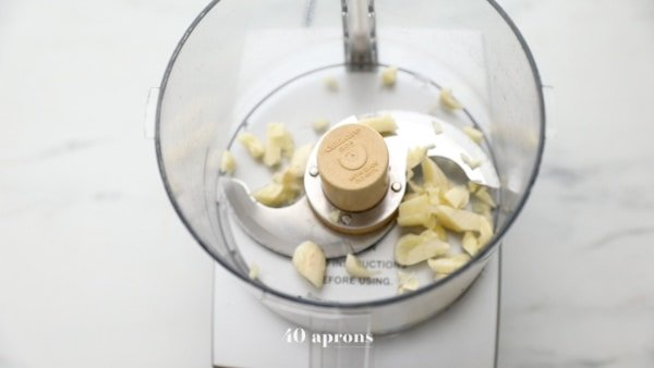 Add garlic to the food processor and pulse until minced
