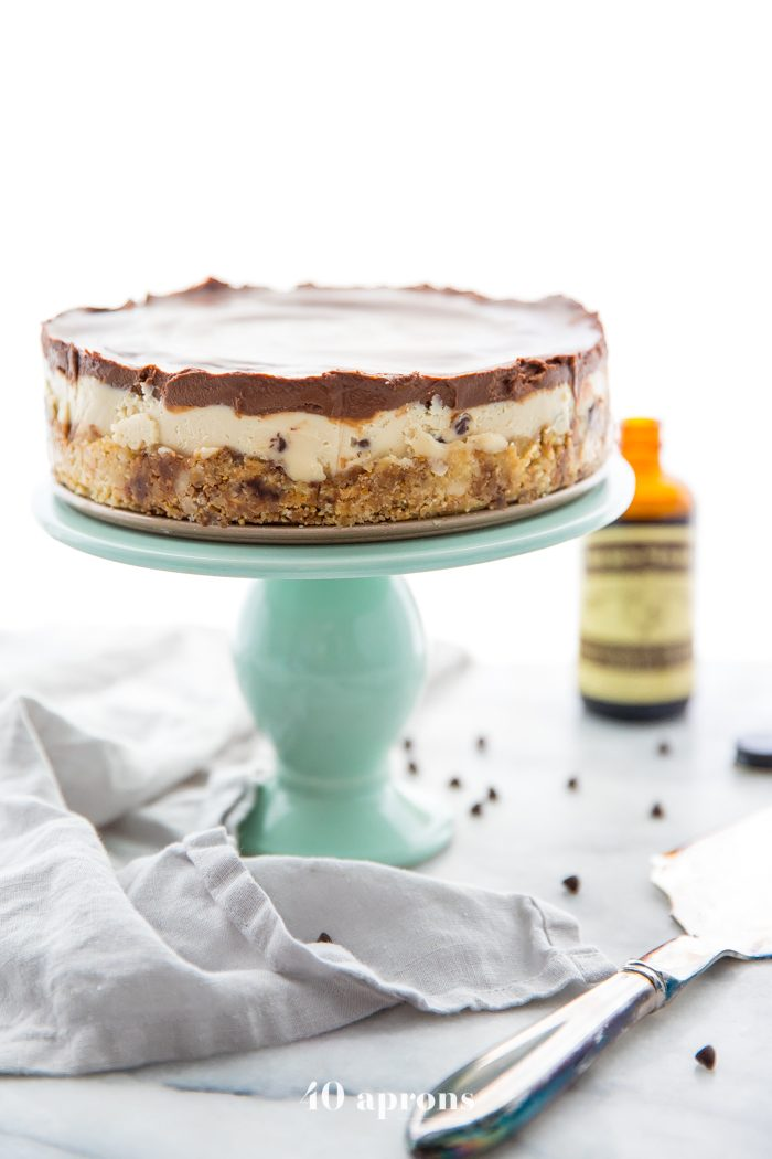Whole vegan no bake cookie dough cheesecake on a cake stand