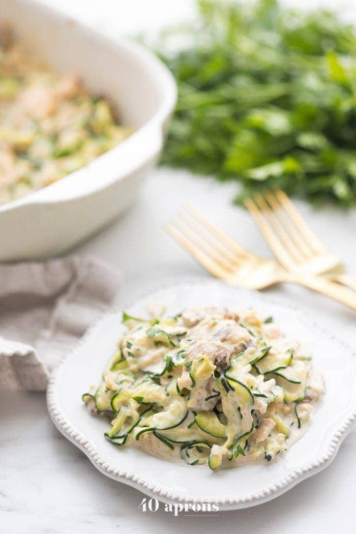 Whole30 tuna zoodle casserole on a plate next to a casserole