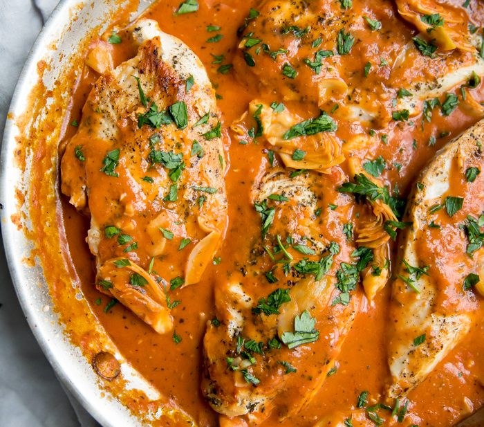 Creamy tomato artichoke chicken (Whole30, paleo) in a skillet