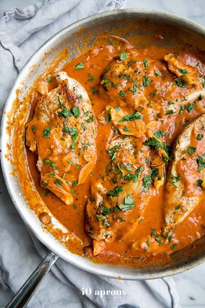 Creamy tomato artichoke chicken (Whole30, paleo) in a skillet