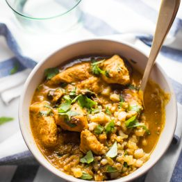 Whole30 chicken curry in a bowl with cauliflower rice