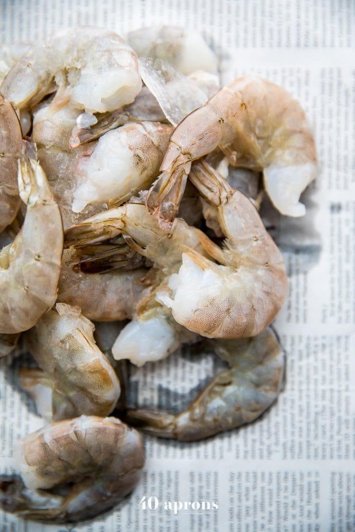 Shrimp on newspaper for a Whole30 shrimp boil