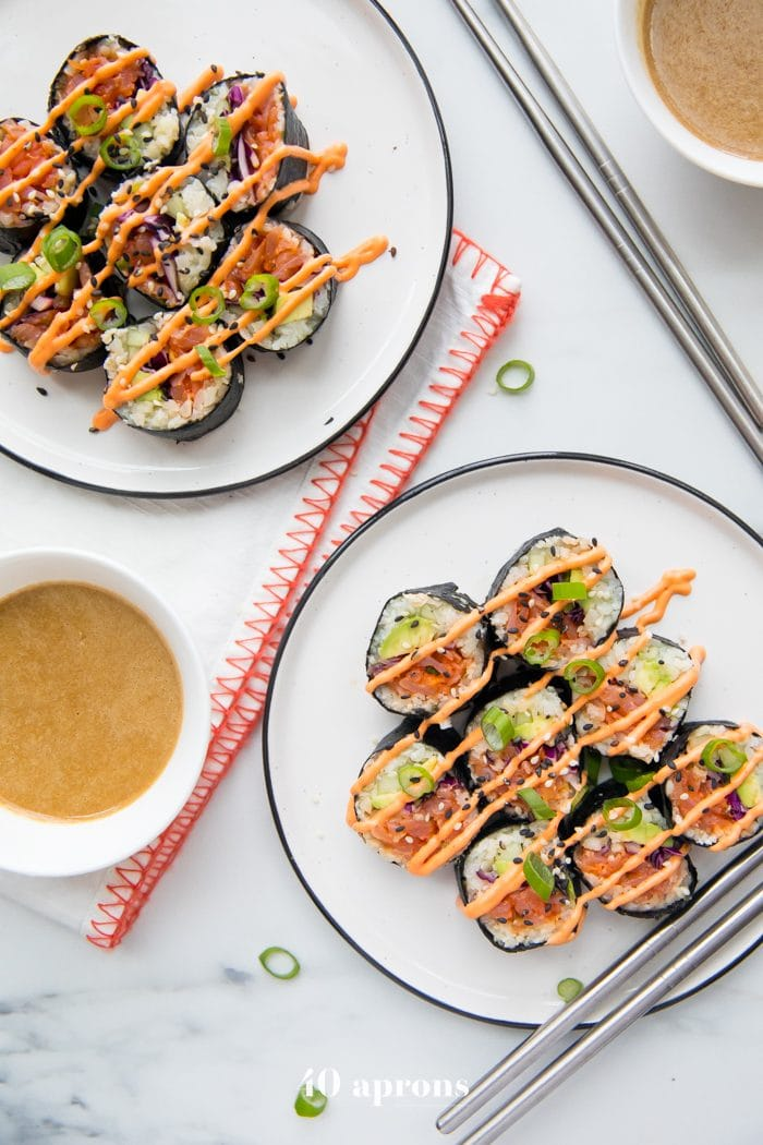 Whole30 sushi spicy salmon roll on two plates