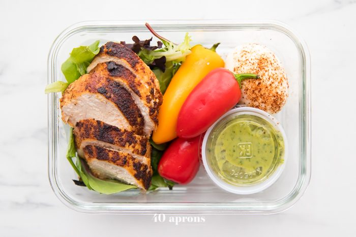 Container of healthy Mexican chicken meal prep stacked on each other