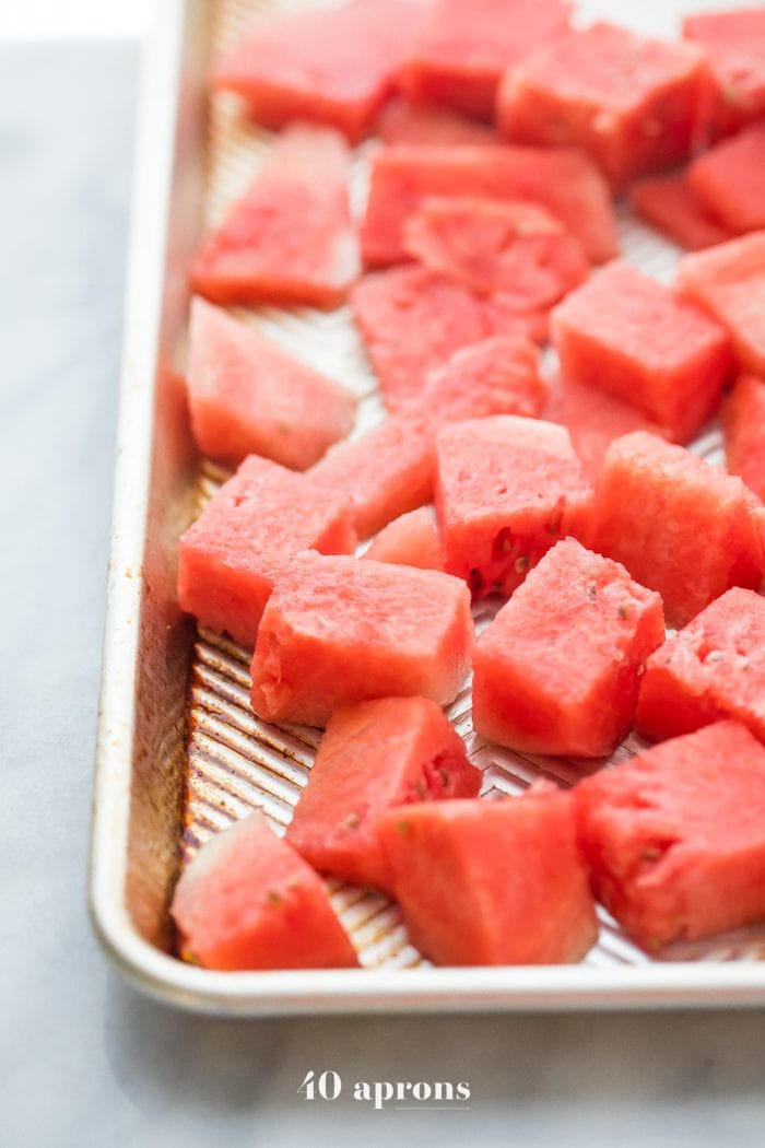Cubed watermelon on a baking pan