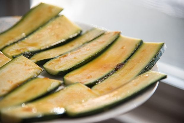 raw zucchini slices freshly glazed with orange glaze