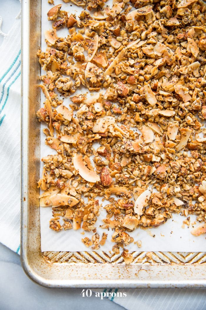 A baking sheet of the crunchy paleo granola recipe spread out over parchment paper