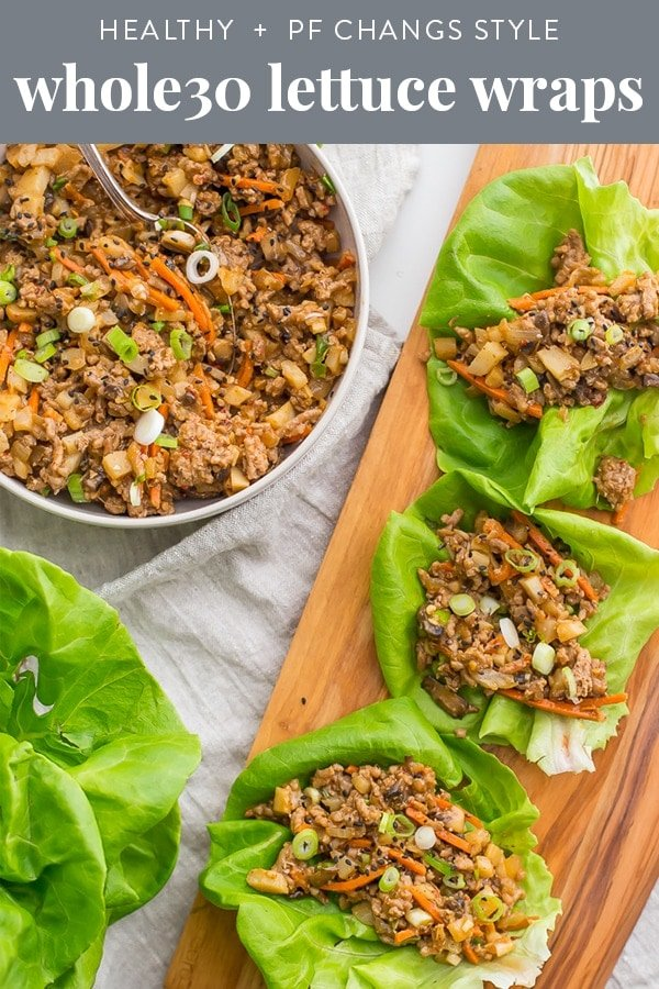 These healthy lettuce wraps are inspired by the PF Changs recipe but are totally Whole30 compliant and paleo. Loaded with flavor and with lots of veggies, these healthy Asian lettuce wraps are made with pork or chicken and are a great, easy Whole30 dinner recipe. They're filling yet light, totally healthy, and slightly sweet yet nutty and spicy.#whole30 #asian #recipe #appetizer #maincourse #healthy #paleo #chicken #pork #cleaneating #realfood