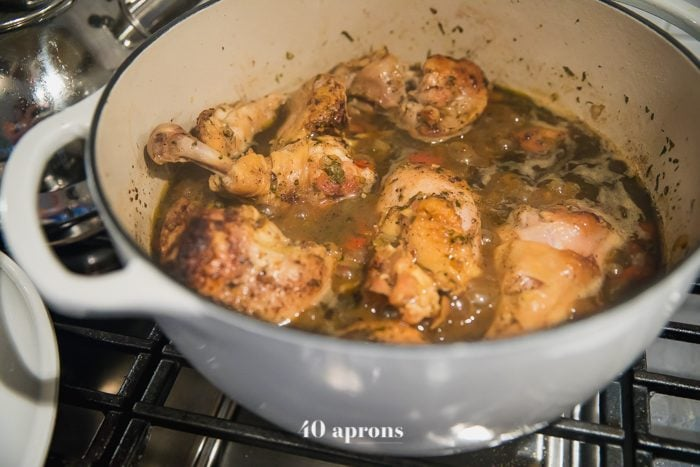 Braise chicken until cooked through