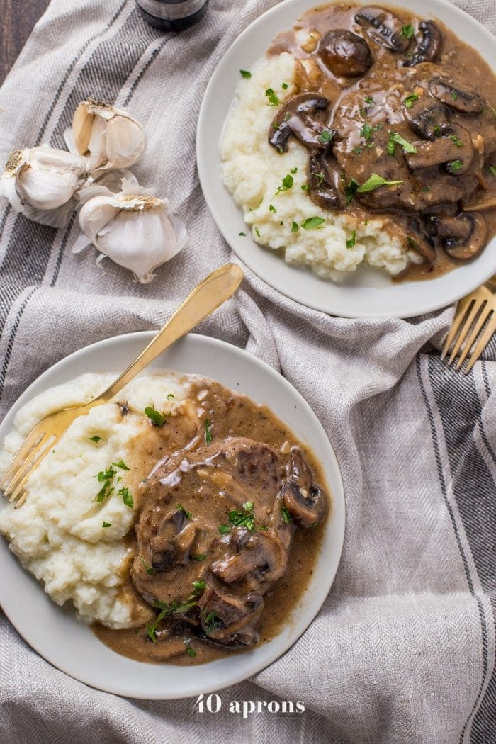 Overhead shot of Whole30 Salisbury Steak served with mashed potatoes and sprinkled with chives