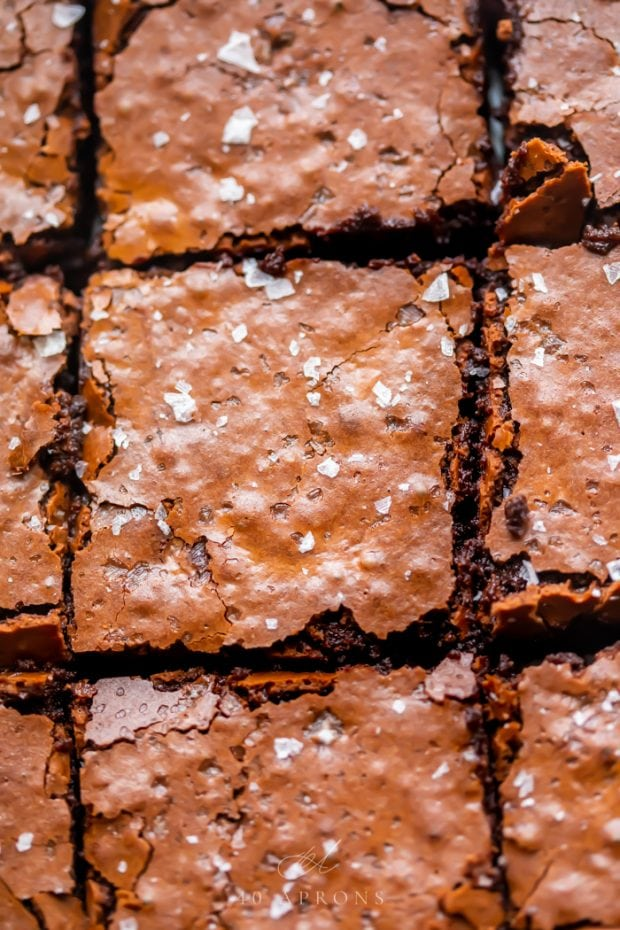 An up-close shot of the crunchy top on these perfect paleo brownies, topped with flake sea salt