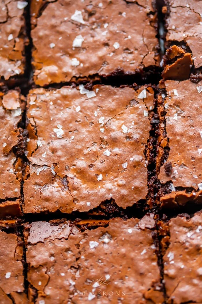 An up-close shot of the crunchy top on these perfect gluten free brownies, topped with flake sea salt