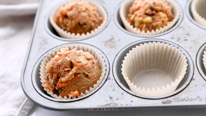 Fill cupcake liners to the top