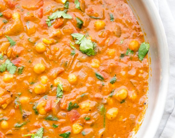 Simmer creamy vegan coconut chickpea curry until rich and reduced slightly