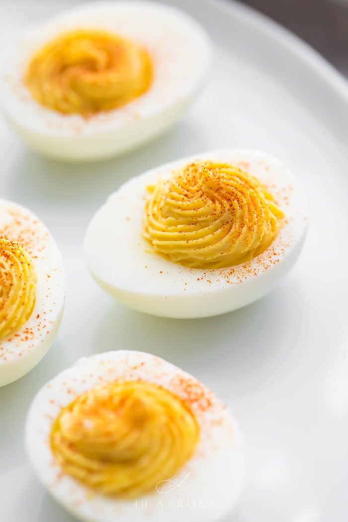 Up close of perfect deviled eggs with yolks piped into center