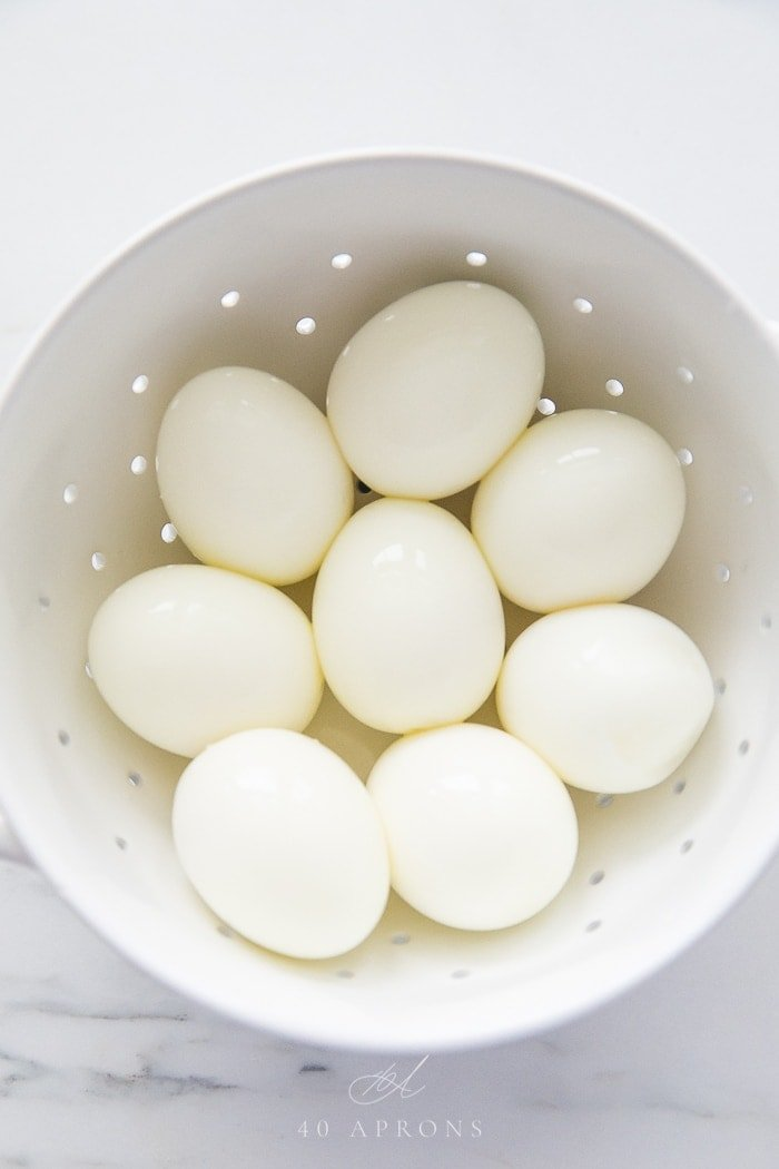 A bowl of perfect peeled soft and hard boiled eggs