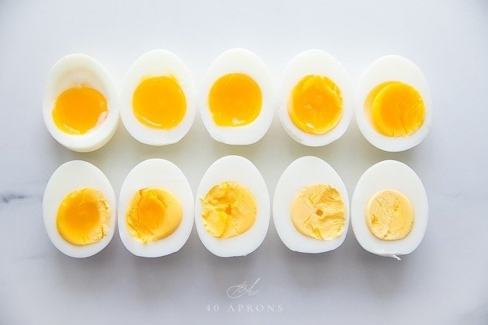 Ten eggs cut in half showing their differently cooked yolks