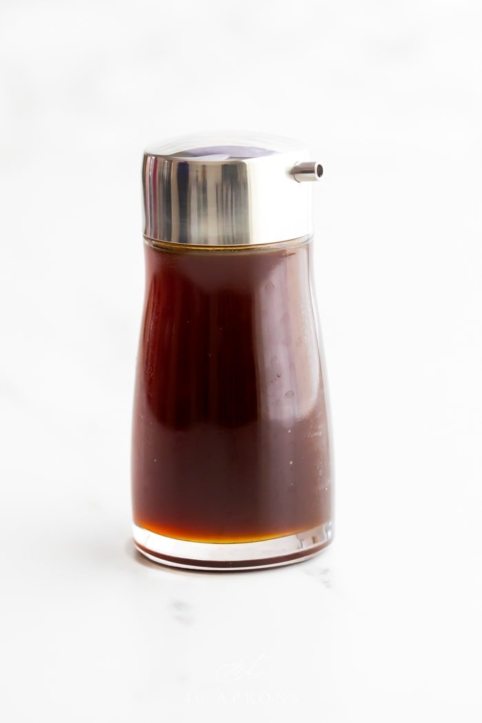 A bottle of healthy soy sauce substitute with a silver pour top