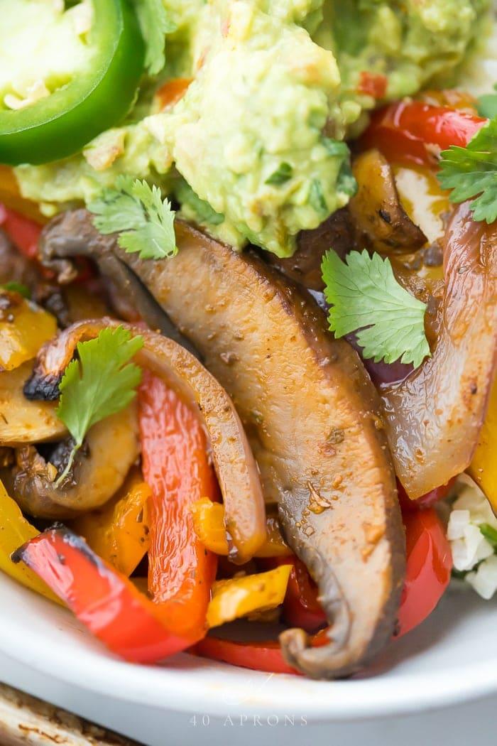 Up close of the sheet pan vegetarian fajitas, mushrooms, and peppers