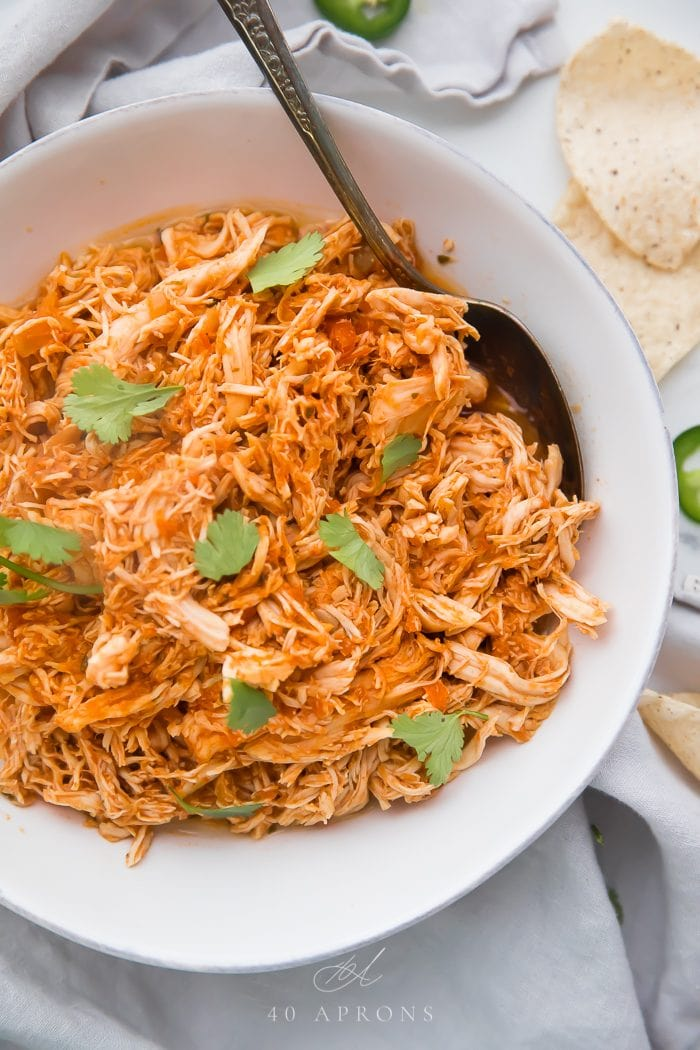 Mexican shredded chicken in a white bowl