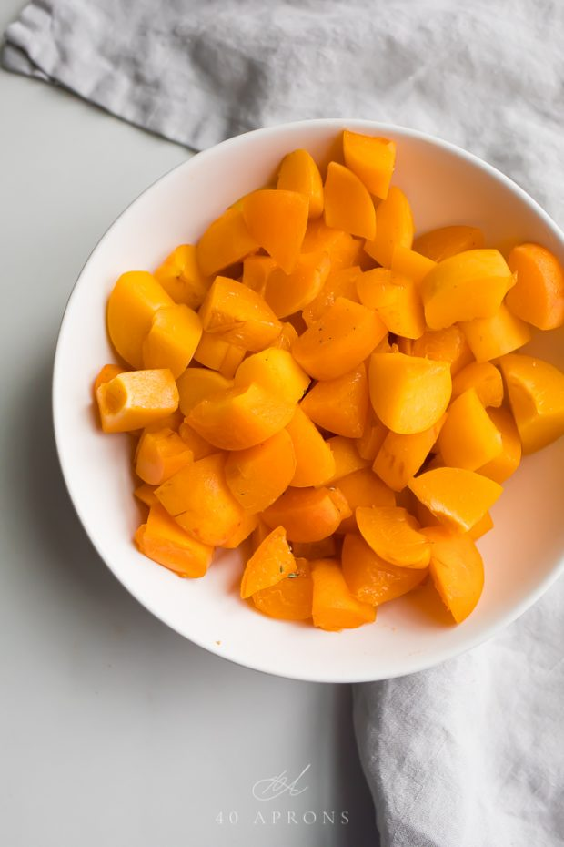Diced apricots in a white bowl