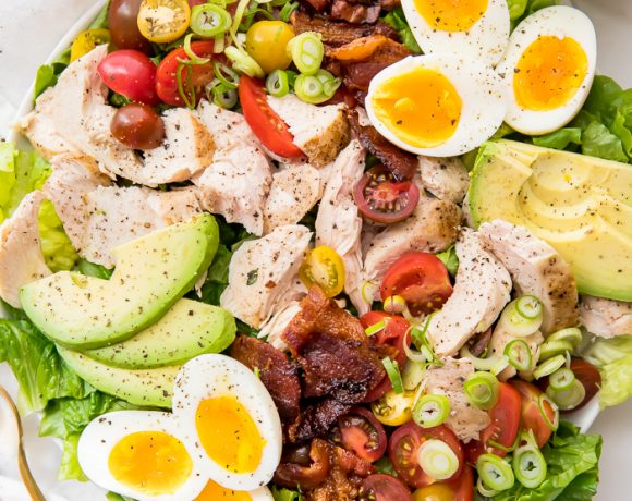 A classic healthy chicken cobb salad on a white plate