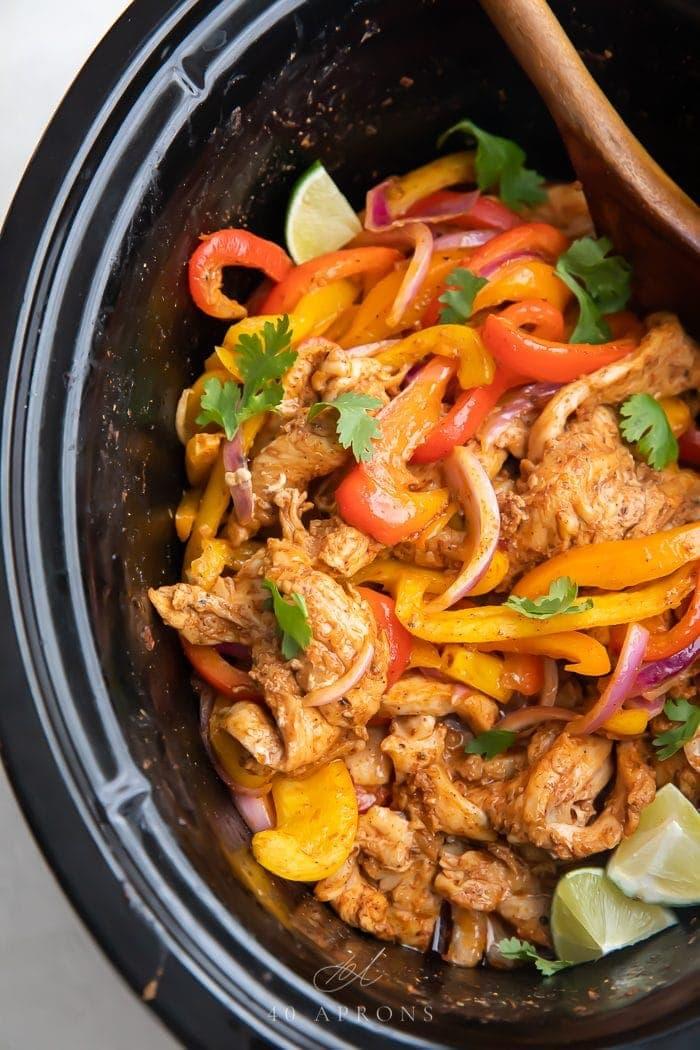 Top down shot of cooked crockpot chicken fajitas