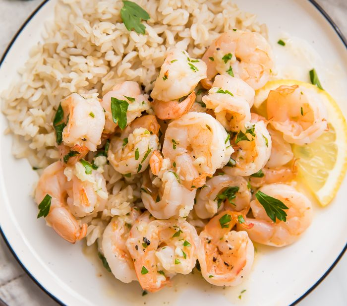 A plate of lemon garlic shrimp over rice