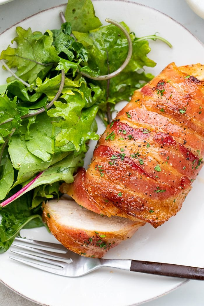 Bacon wrapped chicken served with a side salad