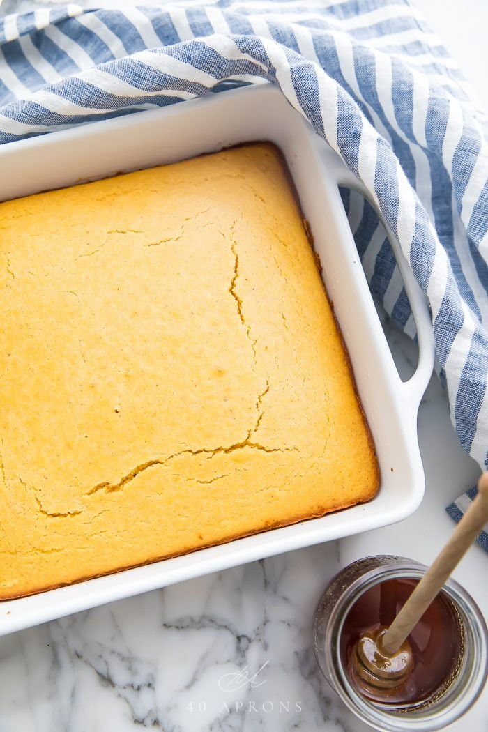 Baked cornbread in a white dish