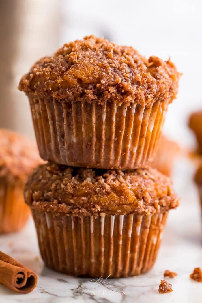 Two healthy pumpkin muffins stacked on top of eachother